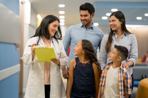 Pediatrician talking to family