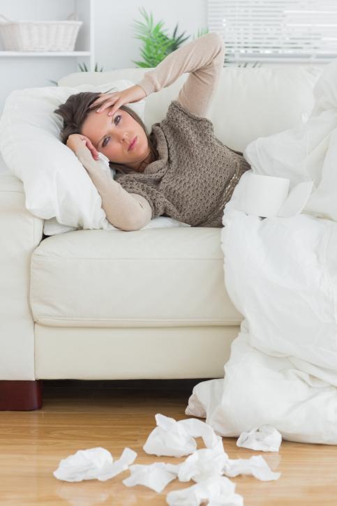 Sick woman laying on a sofa
