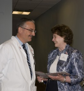 Massimo Cristofanilli with a patient advocate