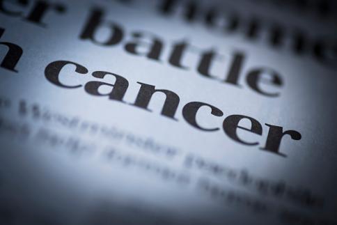 cancer written in a newspaper